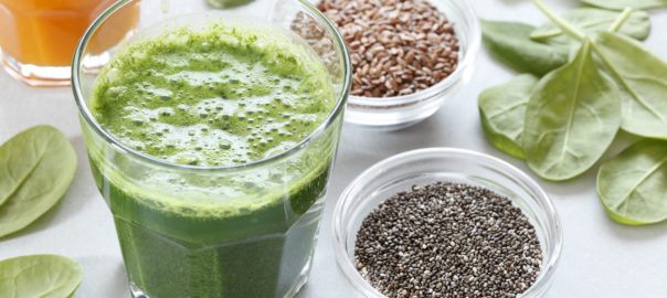 Green superfood smoothie with spinach and seeds.